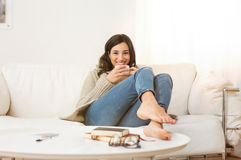 Woman relaxing at home Royalty Free Stock Images