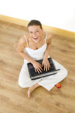 Woman relaxing at home. With her laptop Royalty Free Stock Photo