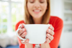 Woman Relaxing At Home With Hot Drink. Looking Down Stock Images