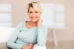 Woman relaxing home. Pretty mid age woman relaxing at home Stock Photography