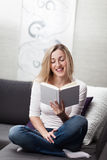 Woman relaxing at home reading a book Royalty Free Stock Photos