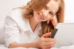 Woman relaxing at home with a Tablet PC Royalty Free Stock Photo