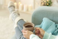 Woman relaxing at home. On winter vacation Stock Image
