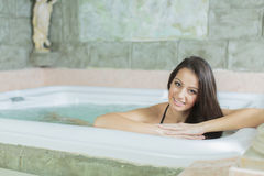 Woman relaxing in the hot tub Royalty Free Stock Photo