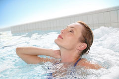 Woman relaxing in hot tub Stock Image