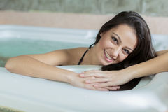 Woman relaxing in the hot tub. Young woman relaxing in the hot tub stock images