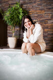 Woman relaxing in the hot tub Stock Photo