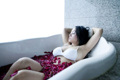 Woman relaxing in hotel bathtub Royalty Free Stock Images