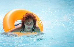 Woman relaxing in the hotel pool Royalty Free Stock Photos