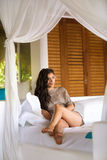 Woman relaxing in hotel room Royalty Free Stock Photography