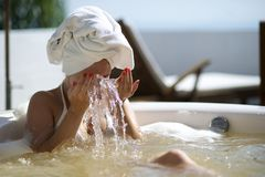 Woman relaxing in a hydromassage bath in Brazil Stock Photo