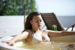 Woman relaxing in a hydromassage bath in Brazil Stock Image