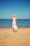 Woman relaxing at italian beach Royalty Free Stock Photo