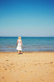 Woman relaxing at italian beach stock images