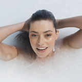 A woman relaxing in a jacuzzi Stock Photography
