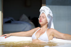Woman relaxing in a jacuzzi in a resort in Brazil Royalty Free Stock Images