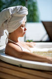 Woman relaxing in a jacuzzi in a resort in Brazil Stock Photography