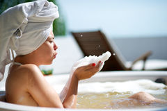 Woman relaxing in a jacuzzi in a resort in Brazil Royalty Free Stock Image