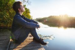 Woman relaxing on jetty royalty free stock images