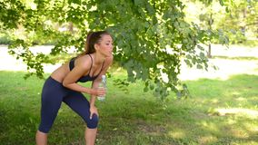 Woman Relaxing After Jogging In The Park stock footage