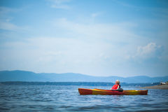 Woman Relaxing on a Kayak and Enjoying her Life. Young Woman Relaxing on a Kayak and Enjoying the Moment of Freedom stock photography