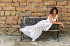 Woman relaxing in lace nightgown Stock Photos