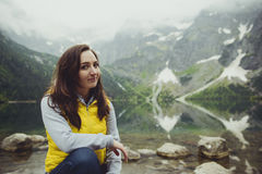 Woman relaxing on the lake and mountains sunny landscape.  Royalty Free Stock Photo