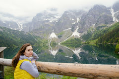 Woman relaxing on the lake and mountains sunny landscape.  Royalty Free Stock Photos