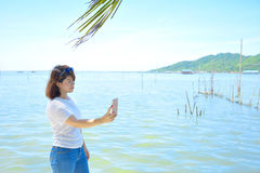 A woman relaxing at lake. In summer Royalty Free Stock Photography