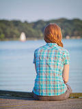 Woman Relaxing at a Lake Stock Images
