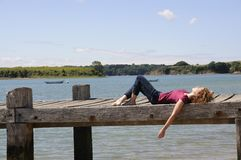 Woman relaxing on landing stage Stock Photography