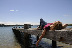 Woman relaxing on landing stage Royalty Free Stock Photos