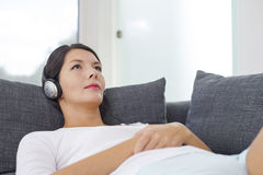 Woman relaxing listening to music Royalty Free Stock Images