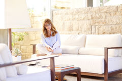 Woman relaxing after a long day Royalty Free Stock Image