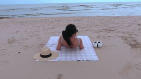 Woman relaxing and looking at the sea stock video