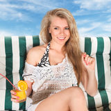 Woman relaxing in lounge royalty free stock image
