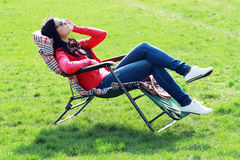 Woman relaxing on lounger Royalty Free Stock Photos