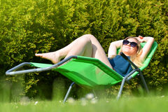 Woman relaxing on lounger. Royalty Free Stock Photo