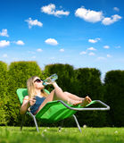 Woman relaxing on lounger. Royalty Free Stock Photography