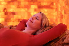 Woman relaxing on lounger at Halotherapy Stock Image