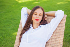 Woman relaxing in a lounger Royalty Free Stock Photography