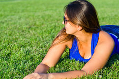 Woman relaxing lying on grass Royalty Free Stock Photo