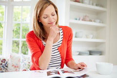 Woman Relaxing With Magazine At Home Stock Photos
