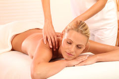 Woman relaxing during massage Stock Image