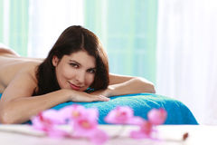 Woman relaxing on a massage bench Stock Photography