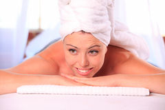 Woman relaxing on a massage table Stock Image