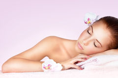Woman relaxing on massage table Stock Photo