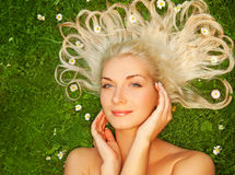 Woman relaxing on a meadow Stock Photo