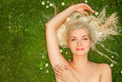 Woman relaxing on a meadow Stock Image
