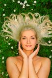Woman relaxing on a meadow Royalty Free Stock Images
